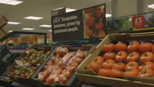 pan onto large tomatoes in boxes in a tesco supermarket, uk. - ascorbic acid stock videos & royalty-free footage