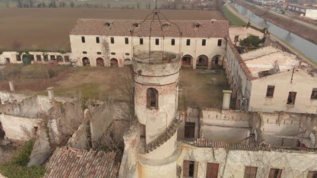 pan over a huge abandoned and destroyed building with a tower and internal court in padan plain region, padua, italy. - crumb stock videos & royalty-free footage