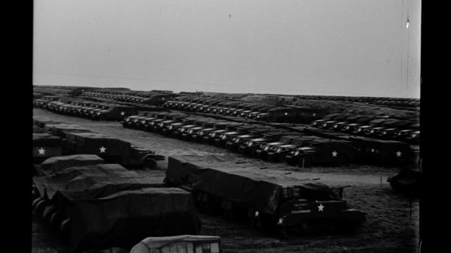 Pan over American military vehicles in vast motor pool in Italy