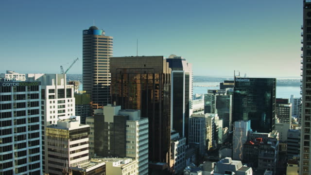 pan over auckland city centre skyscrapers - bay of water stock videos & royalty-free footage
