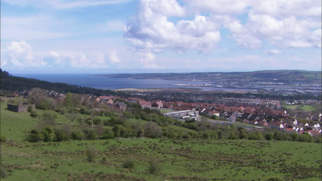 pan over city from afar, belfast, northern ireland - belfast stock videos & royalty-free footage