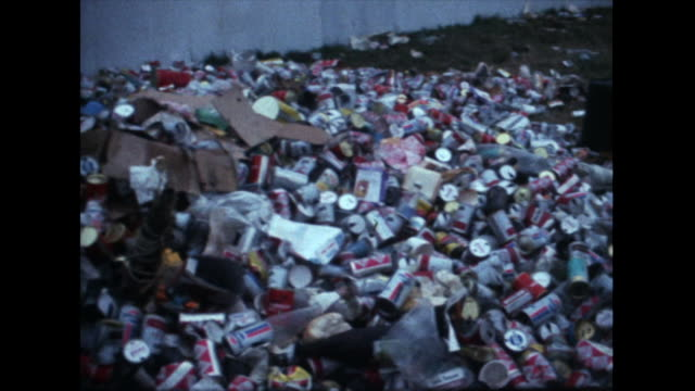 pan over litter and mess after isle of wight festival; 1969 - 以前の点の映像素材/bロール