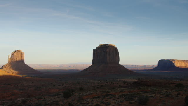 pan over mitten buttes, monument valley - mitten stock videos and b-roll footage