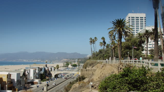 pan over pch and santa monica beach - santa monica stock videos and b-roll footage