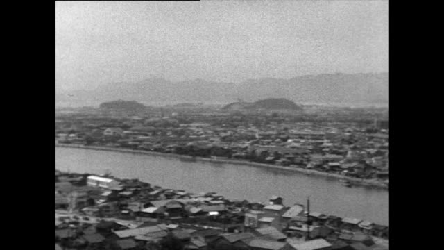 pan over rebuilt hiroshima cityscape; 1958 - nuclear bomb stock videos & royalty-free footage