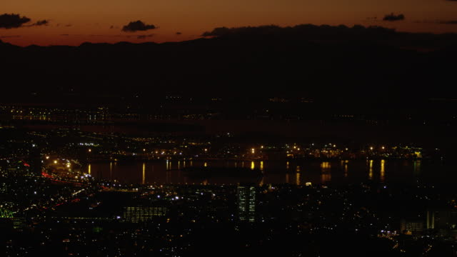 stockvideo's en b-roll-footage met pan over rio de janeiro's waterfront at night with cityscape - baai