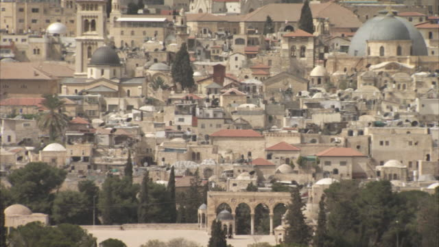 pan over rooftops in the old city of jerusalem onto the dome of the rock. - television static stock videos & royalty-free footage
