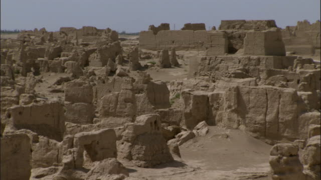 pan over ruins of jiaohe, xinjiang province, china, - stone material stock videos & royalty-free footage