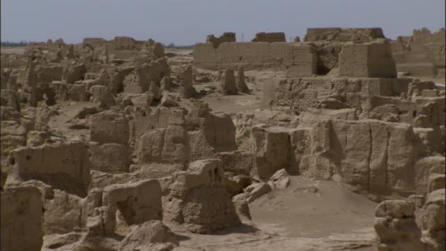 pan over ruins of jiaohe, xinjiang province, china, - old ruin stock videos & royalty-free footage