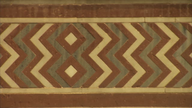 pan over smooth zig-zag detail on which an insect lands in agra fort, india. - zigzag stock videos & royalty-free footage