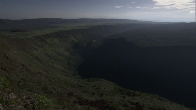 Pan over steep valley, Mount Suswa, Kenya