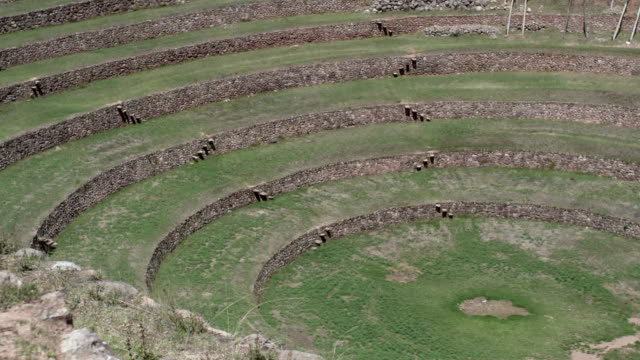 pan over terraces of inca site moray, peru - concentric stock videos & royalty-free footage