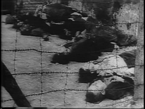 vídeos de stock, filmes e b-roll de pan over the deserted streets of paris / exterior of building with barbed wire / pan showing slain bodies laid out in rows amongst the buildings /... - paramount building