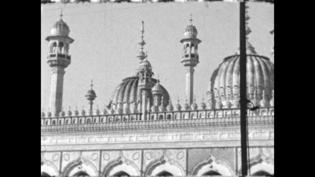 pan over the mosque down fountain in front a few people walking by - colonial stock videos & royalty-free footage