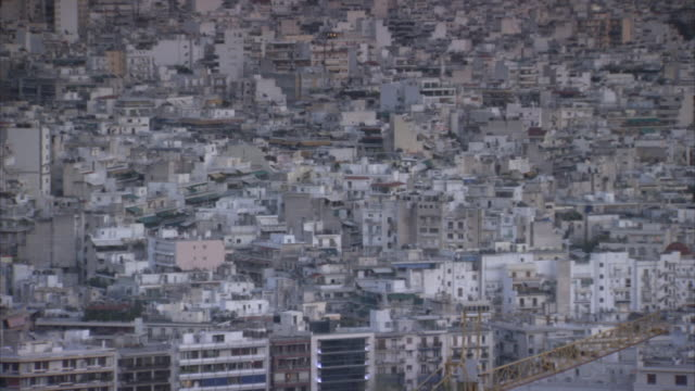 vidéos et rushes de pan over tightly-packed buildings towards the olympic park in the marousi area of athens, greece. - athènes