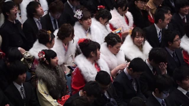 pan over young women dressed in kimonos attending a coming of age day ceremony in kawasaki city kanagawa prefecture japan on monday jan 11 young men... - attending stock videos and b-roll footage