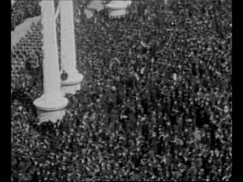 pan people in highrise building watch world war i victory parade from balconies / military cadets march / crowd at victory parade in new york city... - 1910 1919 stock videos and b-roll footage