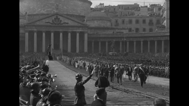 pan piazza del plebiscito filled with spectators / the wedding party proceeds from st francis basilica / ms bride princess anne groom prince amedeo... - フットマン点の映像素材/bロール