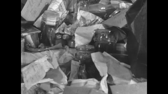 vídeos de stock e filmes b-roll de pan pile of seized drugs and drug paraphernalia / pan opium pipes / ms packages of gum opium / cu marijuana buds voiceover says this is the deadly... - 1931
