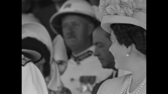 pan princess elizabeth , king george vi in full naval white uniform, queen elizabeth as they stand on platform in basutoland / king george speaks... - 酋長点の映像素材/bロール