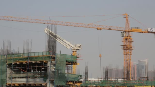 pan r l construction cranes operate at a residential development site operated by skai holdings llc on palm jumeirah artificial island in dubai... - newly industrialized country stock videos and b-roll footage