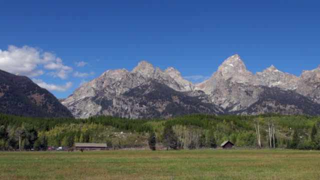 pan: ranch and peaks in grand teton national park - grand teton national park stock videos & royalty-free footage