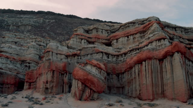 pan: red rock formation in the desert (shot on red) - red rocks stock videos and b-roll footage