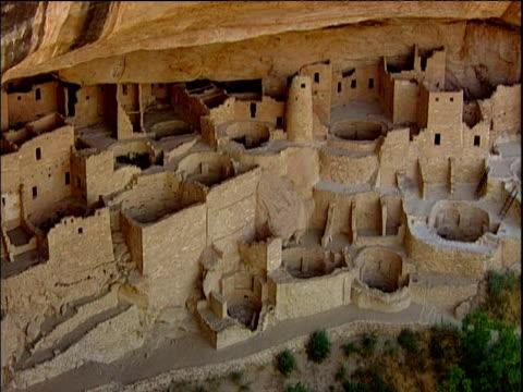 Pan right across ancient cliff dwelling Mesa Verde ruins National Park Colorado