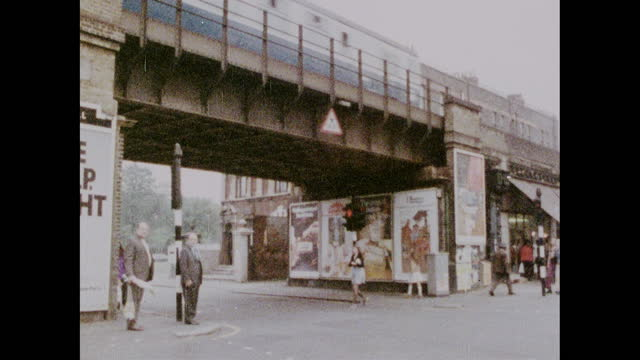 pan right across atlantic road in brixton; 1973 - real people stock videos & royalty-free footage