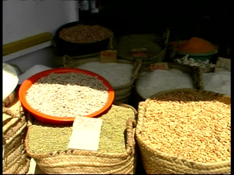 ms pan right across baskets of goods at market, zanzibar island - legume family stock videos and b-roll footage