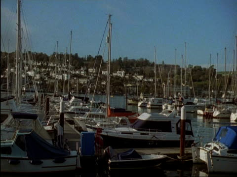 ms pan right across boats moored in dartmouth and kingswear yacht marina, devon, england - dartmouth england stock videos & royalty-free footage