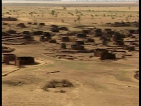Pan right across burnt out Sudanese village after 'earth scorching' by Janjaweed militia Darfur 2004