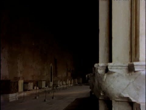 pan right across campo santo cemetery past columns and focusing on the arched windows of the pisa cathedral including dome pisa - pisa cathedral stock videos & royalty-free footage