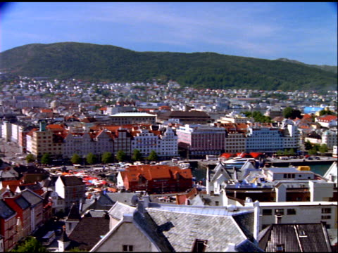 pan right across city at mouth of river, opening out to bay, stavanger - stavanger stock videos & royalty-free footage
