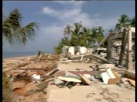 vídeos de stock, filmes e b-roll de pan right across coastal devastation caused by tsunami khao lak thailand 4 jan 05 - oceano índico