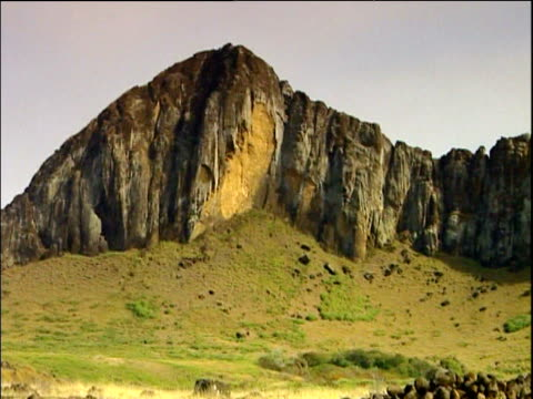 pan right across craggy outcrop where moai statues were quarried easter island - outcrop stock videos and b-roll footage