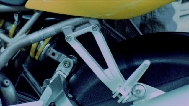 vidéos et rushes de pan right across ducati motorcycle / pan left - procédé croisé