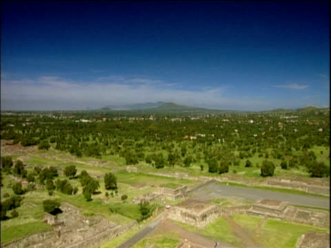 pan right across green landscape to temple of the sun teotihuacan - ancient stock videos & royalty-free footage