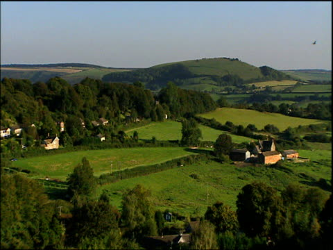 pan right across houses farms fields and trees dorset - perfection stock videos & royalty-free footage