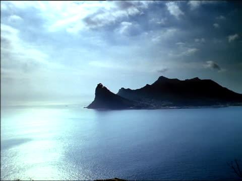 Pan right across Karbonkelberg peak overlooking Hout Bay, South Africa