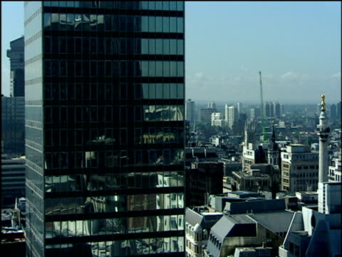 pan right across london skyline overlooking the monument rooftops and cranes city of london - monument stock videos & royalty-free footage