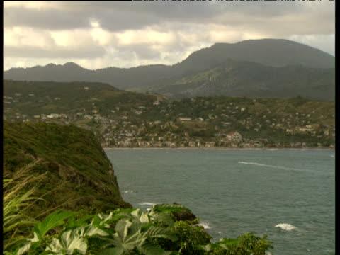 stockvideo's en b-roll-footage met pan right across mountainous bay windward islands - plant attribute
