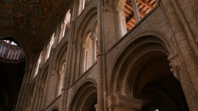 pan right across nave of ely cathedral - column stock videos & royalty-free footage