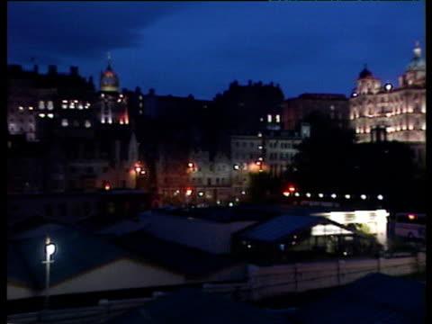 pan right across night skyline to edinburgh castle - edinburgh castle stock videos & royalty-free footage