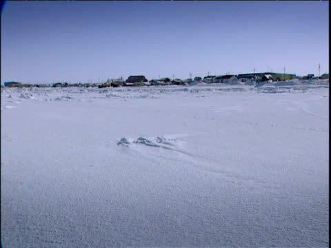 pan right across remote eskimo village alaska - inuit stock videos and b-roll footage