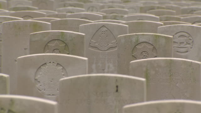 Pan right across rows and rows of headstones in Tyne Cot Cemetery for Commonwealth soldiers of WWI Belgium FKAZ191X Clip taken from programme rushes...