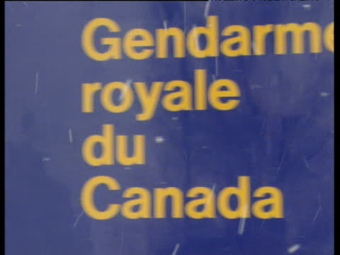 pan right across royal canadian mounted police sign and police headquarters - headquarters stock videos & royalty-free footage