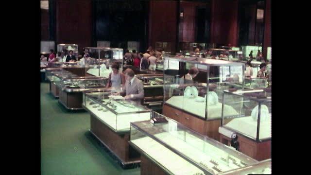 pan right across sales floor inside tiffancy & co. jewellers in new york;1980. - wealth stock videos & royalty-free footage