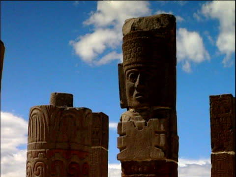 Pan right across stone Giants of Tula statues Mexico
