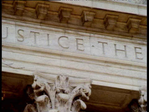 Pan right across Supreme Courts of Justice building inscription on main lintel reads